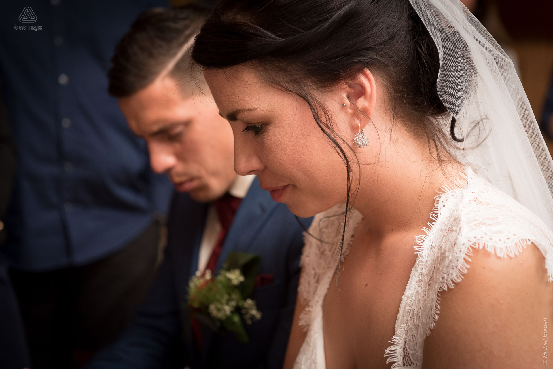 Bridal photo in which the bridal couple is blessed | Kevin Leonie | Wedding Photographer Michiel Borgart - Forever Images.