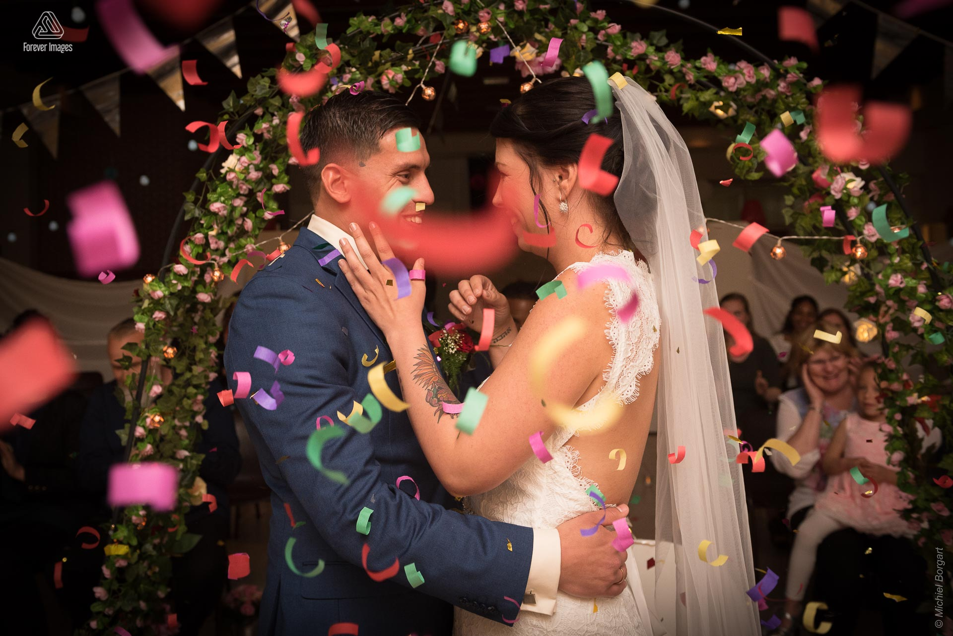 Bridal photo wedding couple immediately after the kiss with confetti | Kevin Leonie | Wedding Photographer Michiel Borgart - Forever Images.