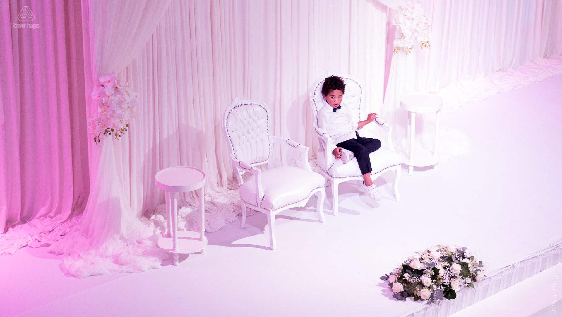 Bridal photo in which the son is married on the wedding chairs | Clarence Sabrina Versteeg | Wedding Photographer Michiel Borgart Forever Images.