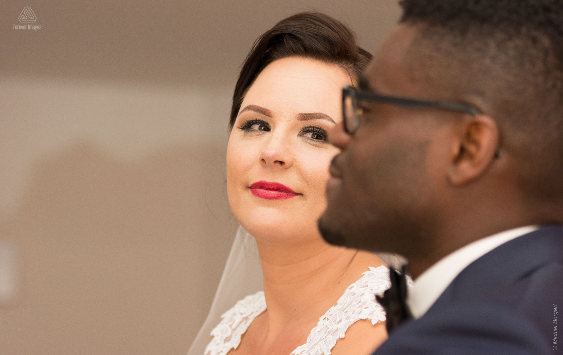 Bridal photo portrait photo close up bride looks groom in love Amsterdam | Clarence Sabrina Versteeg | Wedding Photographer Michiel Borgart - Forever Images.