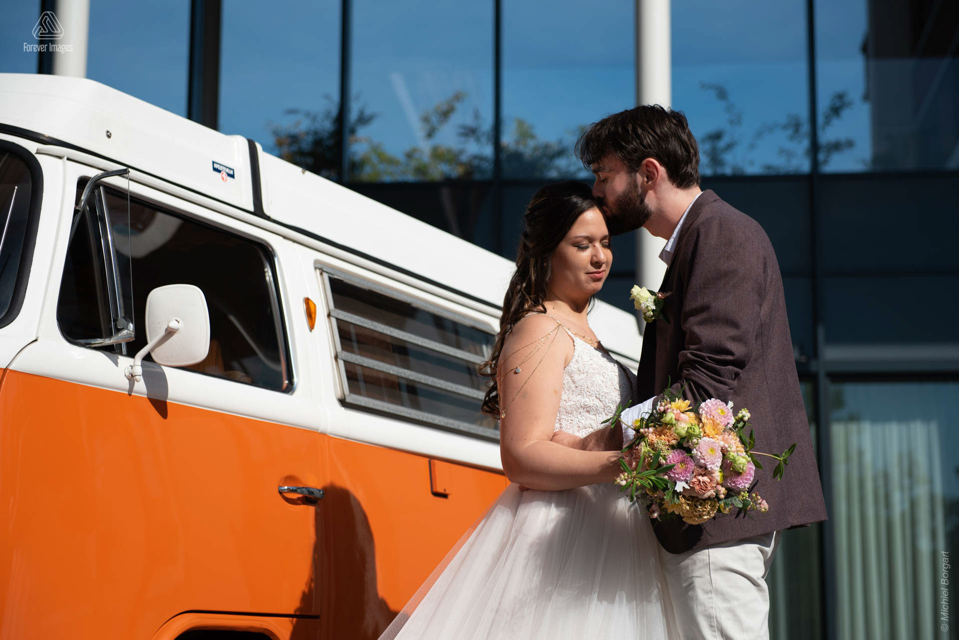 Bridal photo wedding couple in front of bridal car volkswagen van white orange | Wedding Photographer Michiel Borgart - Forever Images.