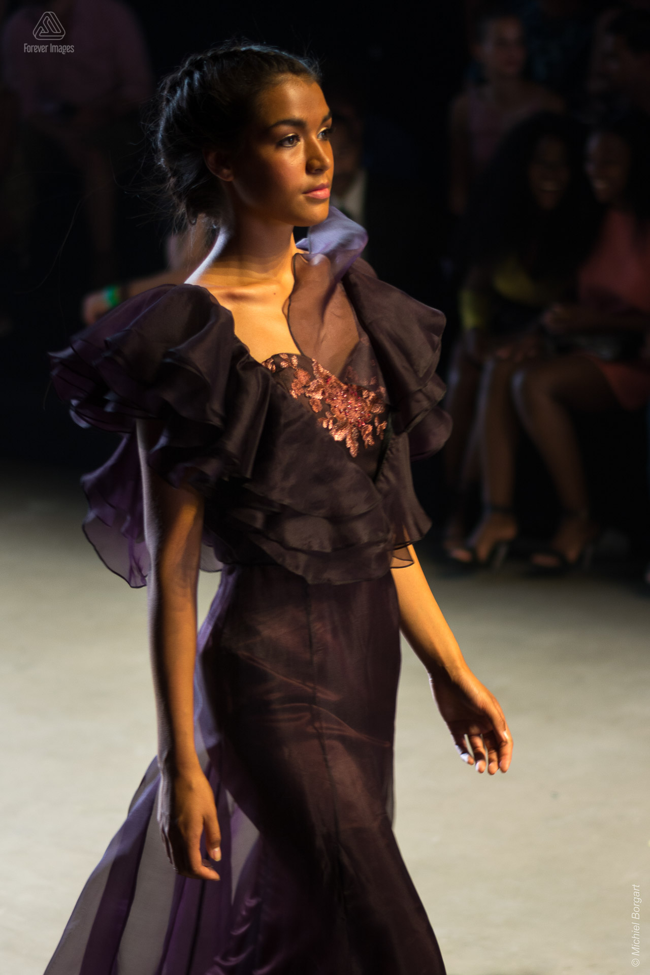 Fashion photo model in dark purple dress during Amsterdam Fashion Week | Fashion Photographer Michiel Borgart - Forever Images.