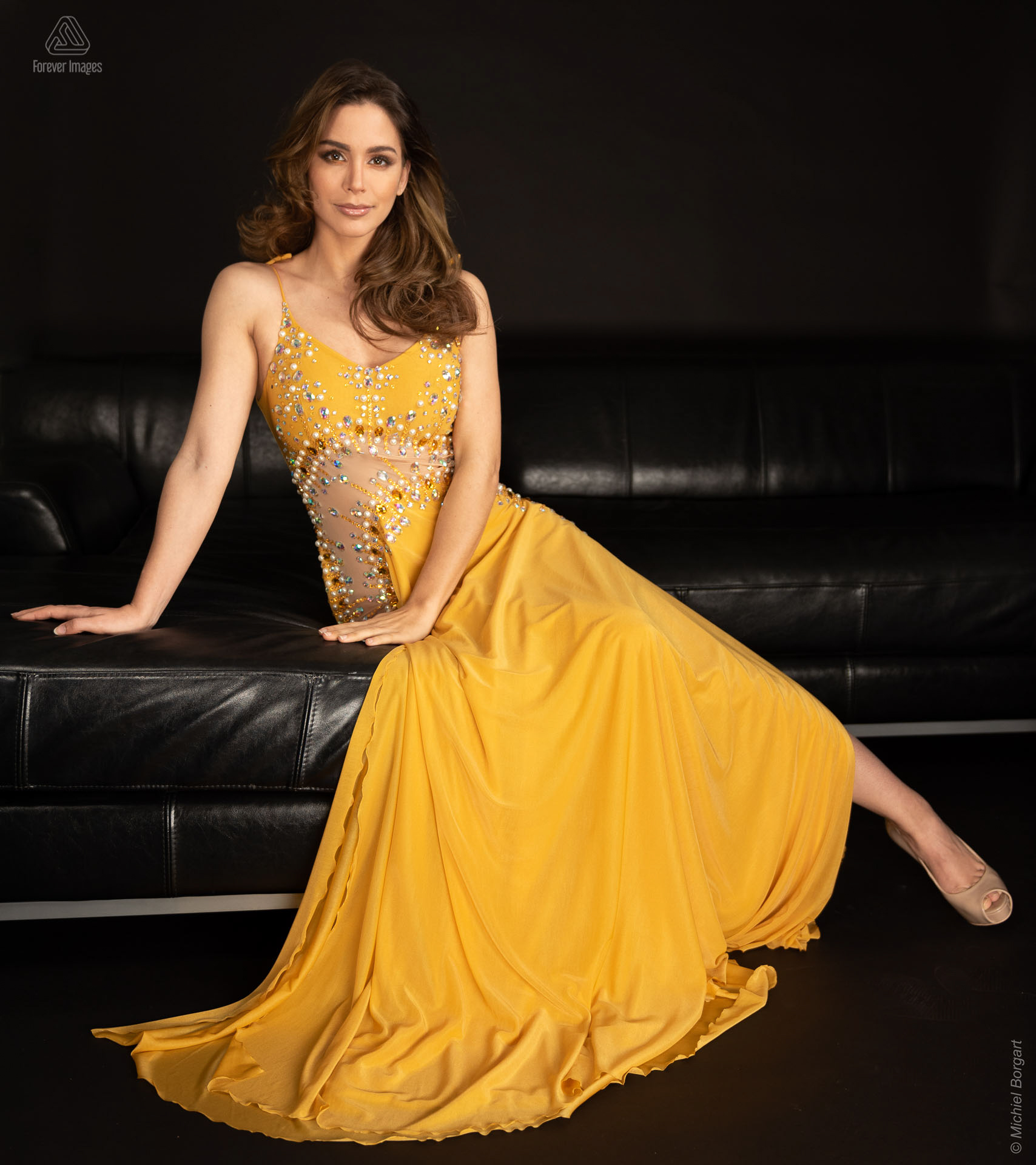 Fashion yellow dress leaning | Nathalie den Dekker Miss Universe World Netherlands International | Fashion Photographer Michiel Borgart - Forever Images.