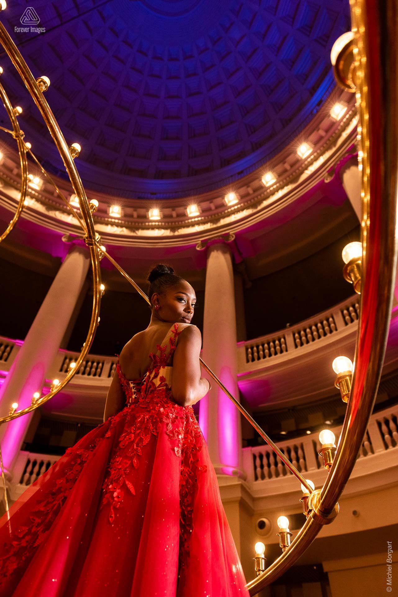 Fashion photo red evening dress chandelier back | Mariana Pietersz Duc Nguyen Koepelkerk Amsterdam | Fashion Photographer Michiel Borgart Forever Images.