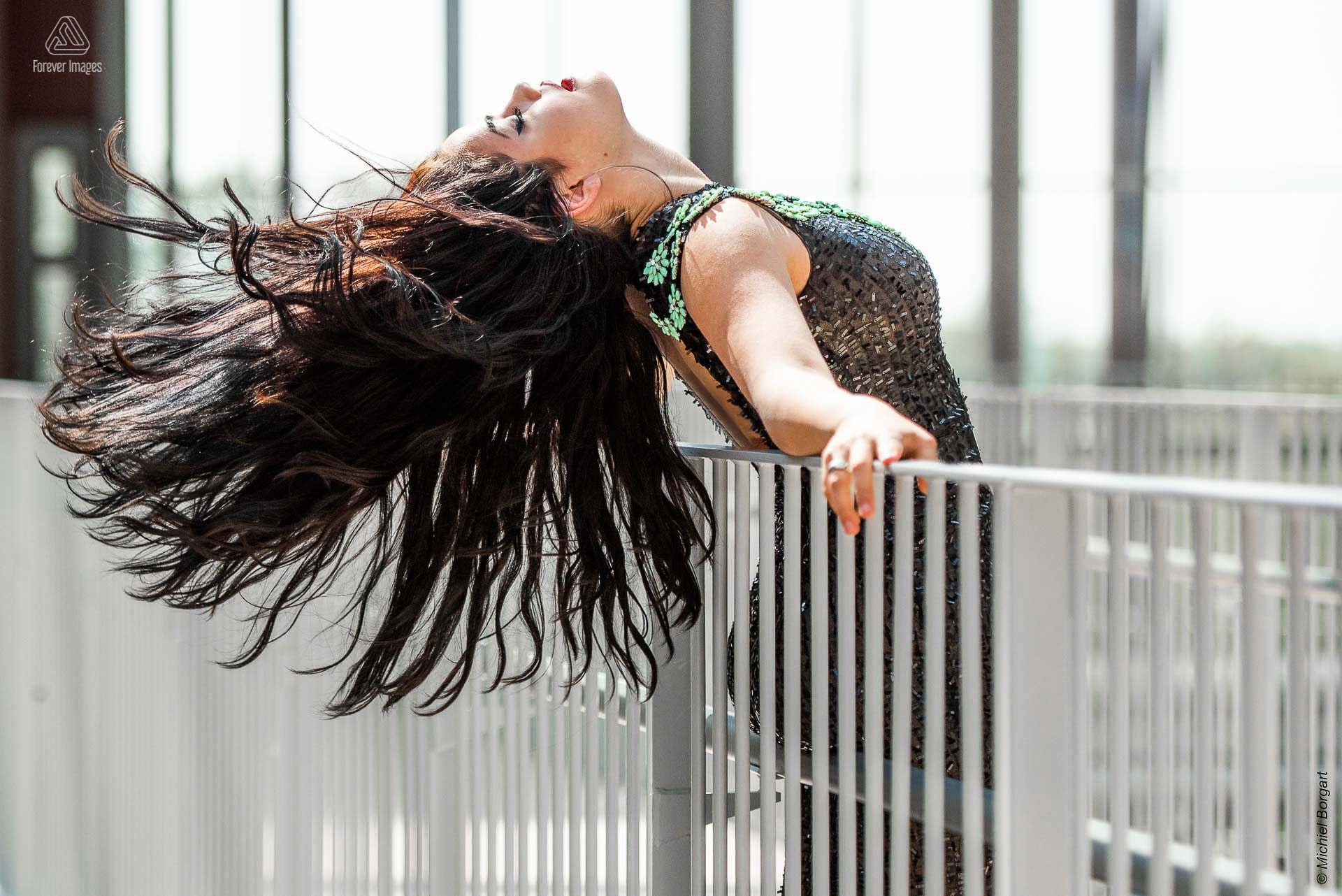 Fashion photo portrait lady hair flip over railing black dress | Daphna Akkermans David Cardenas | Fashion Photographer Michiel Borgart - Forever Images.