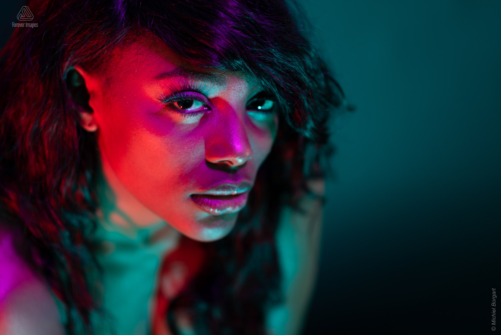 Portrait photo model purple red green light from above low key | Mariana Pietersz Miss Avantgarde | Portrait Photographer Michiel Borgart - Forever Images.
